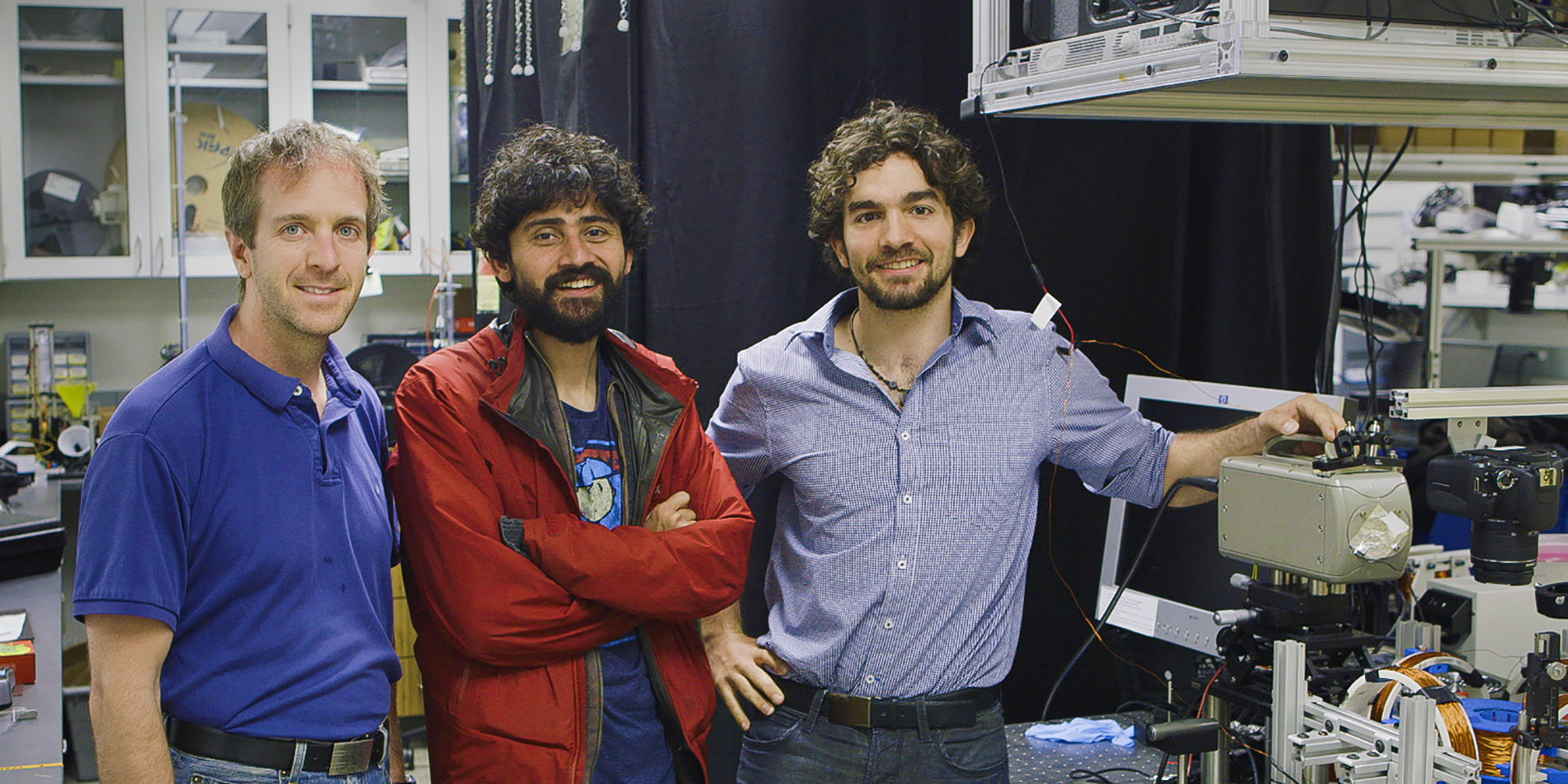 Professor Manu Prakash and two other men in a research lab