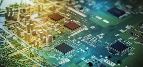 A tilt-shift photo of a computer chip with models of city skyscrapers on top